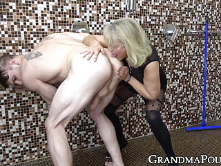 Glamorous Granny In Stockings Strips Youngster To Suck Cock