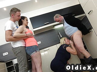 Young And Old Foursome With Old Grandparents And Teen Babe