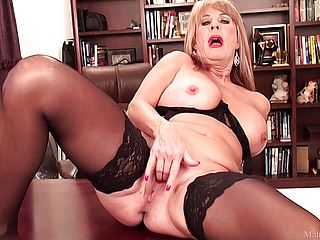 Promiscuous Mature Platinum Blonde Rae Hart Chooses Posing And Toying With Her Sissy