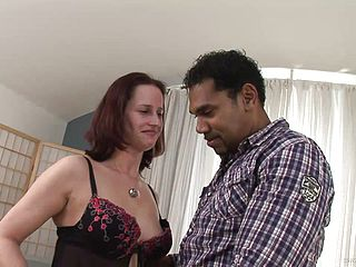 Interracial Orgy For A Trampy Mature Redhead
