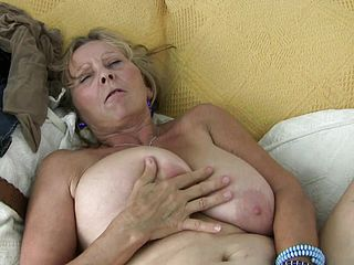Chubby Grannie Isabel And Her Thick Bra Stuffers Work Her Thumbs On Her Slit
