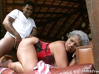 Black Grandma In A Crimson Harness Gets Fucked By A Youthfull Thugs Cumbot