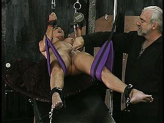 Marionette Dangles In Suspension While Her Lips And Vag Get Taunted