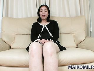 Spunky Chinese Mummy Sits On The Couch, Impatient To Sate Her Naughty Sexual Fantasies