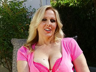 Great As Pummel Blond Cougar Whips Her Ample Fun Bags Out In The Yard