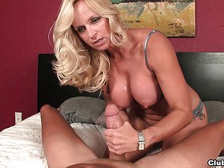 Stacked Light Haired Milf Dani Dare Wanks A Big Rod Dry With Her Knockers And Knuckles
