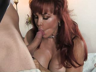 Enrapturing Red Haired Mummy With Big Hooters Wraps Her Obscene Lips Around A Bone