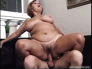 Insane Ginger Haired Mummy With Phat Mounds Has A Youthful Man Satisfying Her Sexual Needs