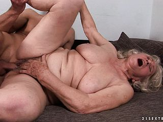 Large Saggy Knocker Grandma Gets A Lad To Do The Filthy With Her