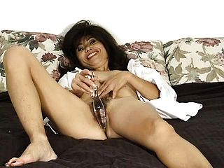 Nasty Oriental Mummy Song Tucks A Glass Faux Cock Inwards Her Narrow Vulva